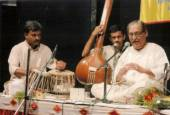 Panditji singing in a concert with Girish Nalavade on the tabla and Mukul Kulkarni providing vocal support